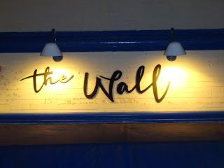 Comfortably Satisfied at the Wall in Orange