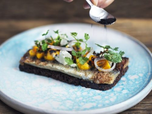 Smørrebrød: Marinated herring with orange and pumpkin