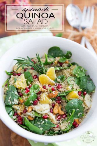 Spinach Quinoa Salad with cashews, orange, water chestnuts and pomegranate seeds
