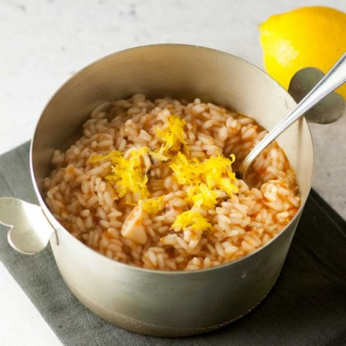 Risotto with squid and tomato sauce