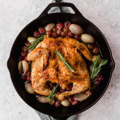 Spatchcocked chicken with grapes