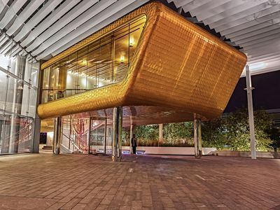 Much Anticipated Dallas Restaurant Looks Like an Elevated Garage With Gold Scales