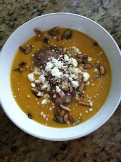 Butternut squash soup with meatballs, roasted pumpkin seeds, and cotija cheese