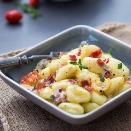 Baked gnocchi in wine sauce