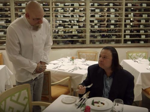 Watch Sacha Baron Cohen Convince a Food Critic to Eat Human Flesh