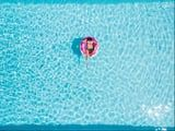The Perfect Pool Party Needs This Summer-Ready Playlist