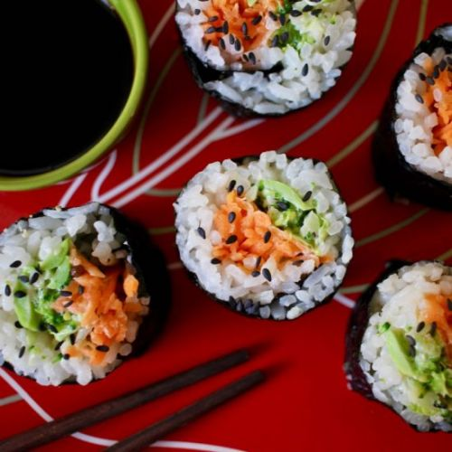 Sushi with pickled carrot + greens