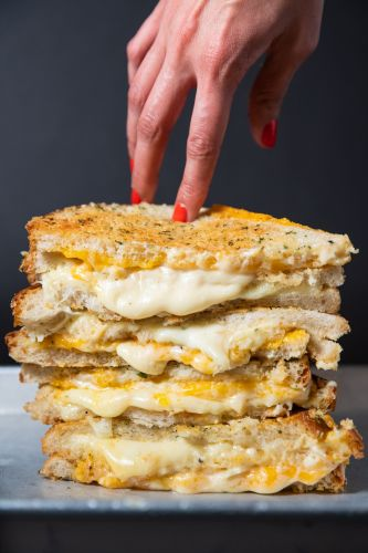 """Melt Shop Debuts Triple Decker """"Notorious Chz"""" for National Grilled Cheese Month"""