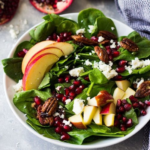 Spinach apple pomegranate salad