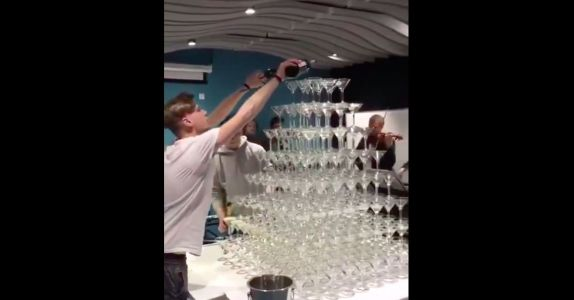 Unlucky Man Shows How Not to Pour a Champagne Tower