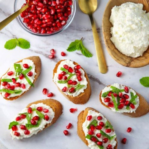 Pomegranate Crostini with Ricotta
