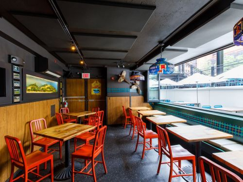The Warped Reality of a Dive Bar By Design