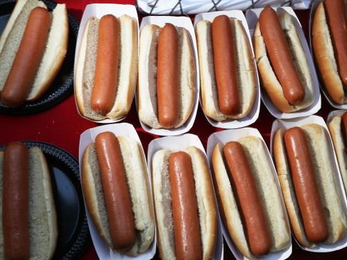 Watch a Competitive Eater Demonstrate How to Pound Three Hot Dogs in 30 Seconds