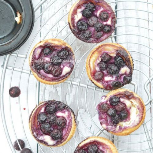 Small blueberry cheesecakes