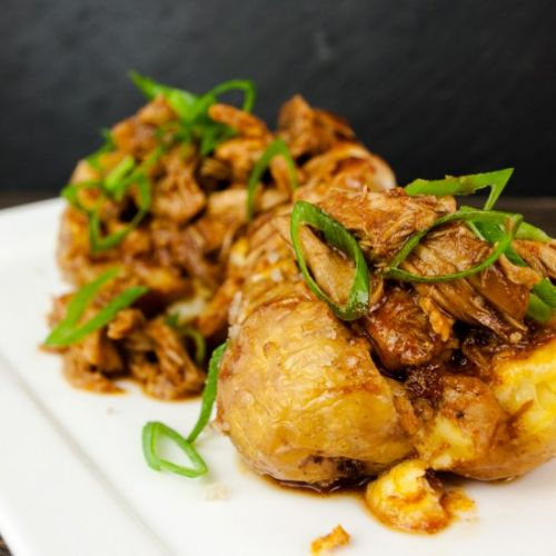 Pulled chicken on roasted potatoes